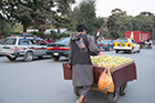 Fruit cars compete with trucks, taxis and cars on the streets of Kabul