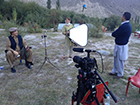 Setting up an interview with Greg Mortenson in the hills above Skardu, Pakistan