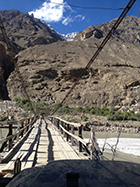Crossing one of the many plank bridges heading into the mountain villages, Baltistan, Pakistan, 2013