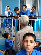 Jeff showing schoolchildren his footage in a CAI school outside of Kabul, Afghanistan, 2013